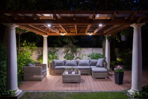 Photo of relaxing area outside of mansion at night - photo by Vision Green Landscape